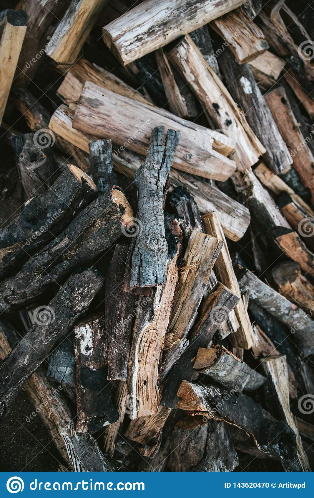 Pile of dried and burnt wood fire logs for fire camp in the Akha village of Maejantai on the hill in Chiangmai, Thailand