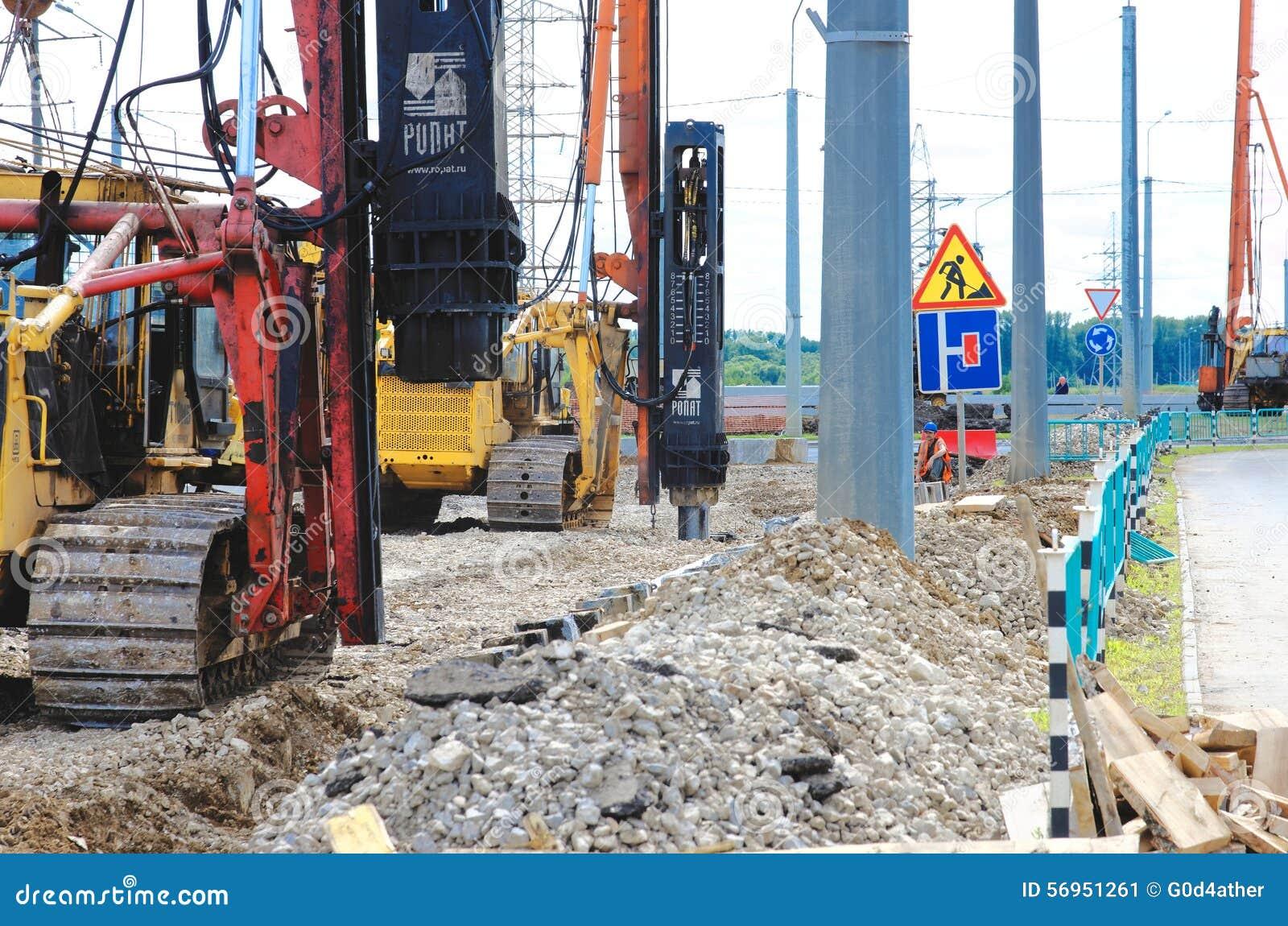 Concrete Piling Repair : Crane driver works to set precast concrete piles for