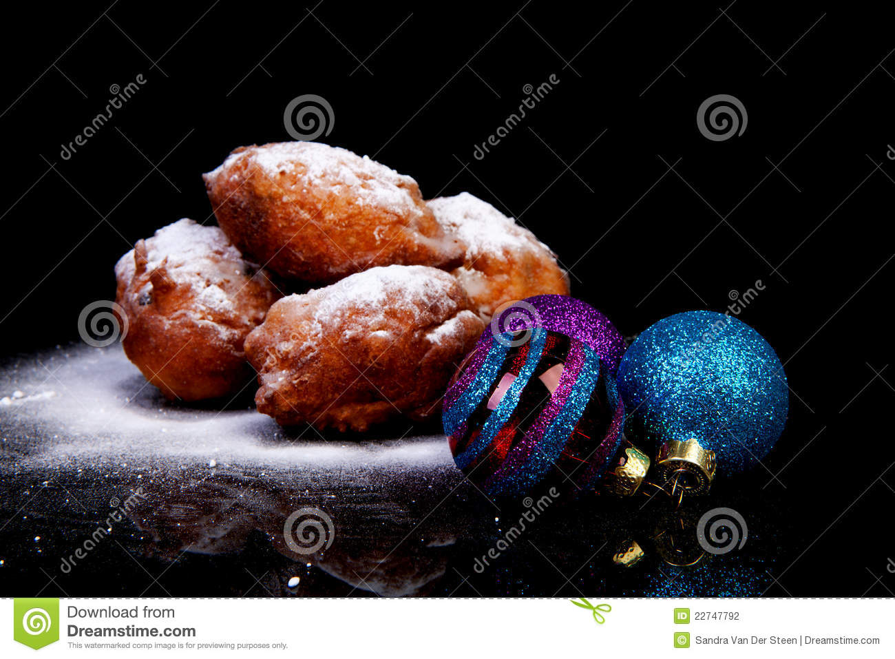 Pile of Dutch oliebollen and Christmas balls