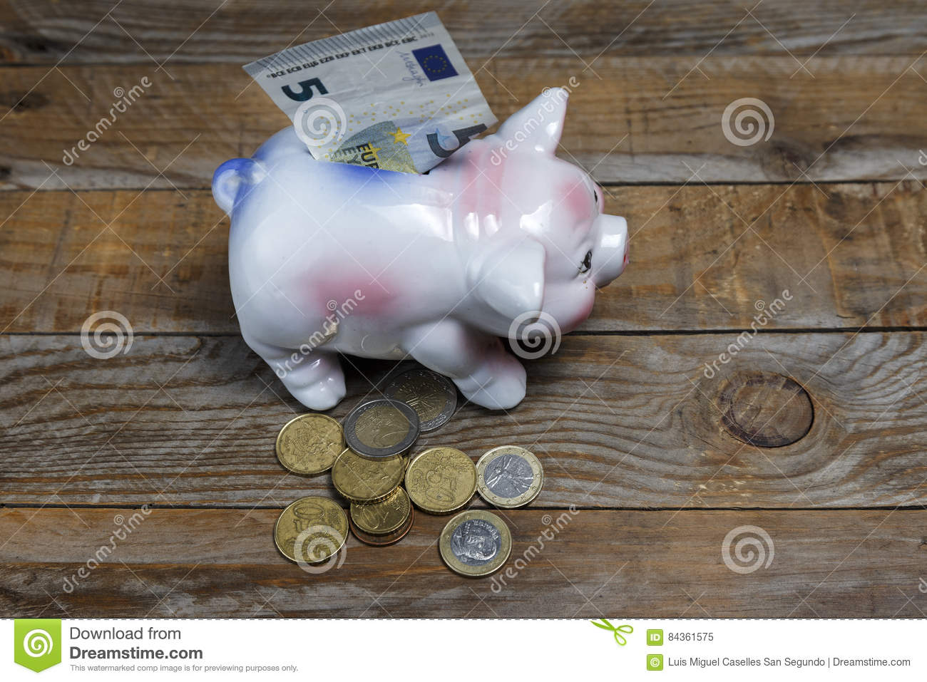 Pile of euro coins and a piggy bank