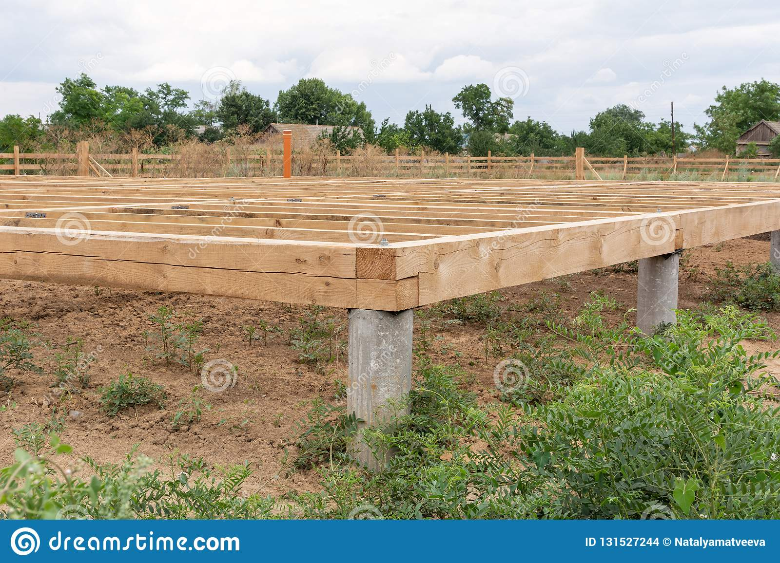 On Pile Foundations Support The Floor Of A Frame House Stock Photo