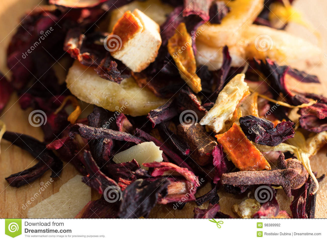 Pile of fruit tea with petals and dry fruit e composition of the pile of fruit tea with petals and dry fruit e composition of the heap of tea leaves and dried hibiscus flower located on a wood izmirmasajfo Images