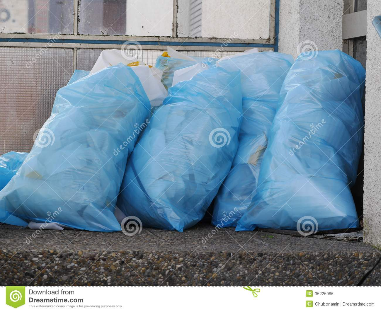A Pile Of Full Garbage Bags In A Dump Royalty Free Stock ...