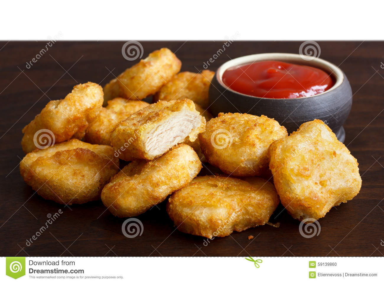 Pile of golden deep-fried battered chicken nuggets with empty ru