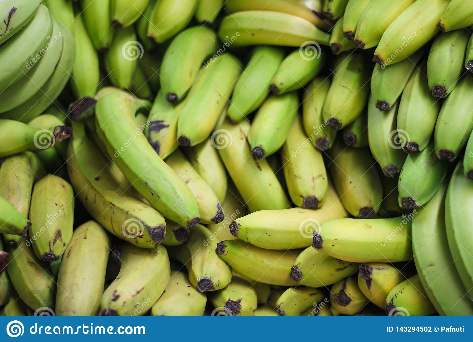 Pile of green bananas on the farmers market or shop