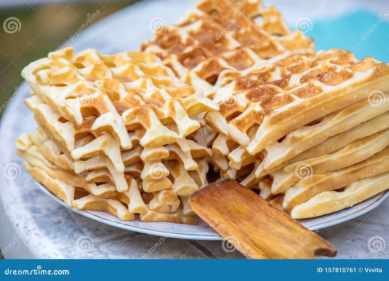 A pile of homemade Belgian Waffles