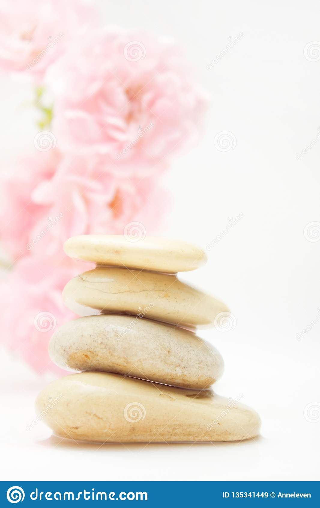pile of hot massage stones - beauty, spa and body care styled concept