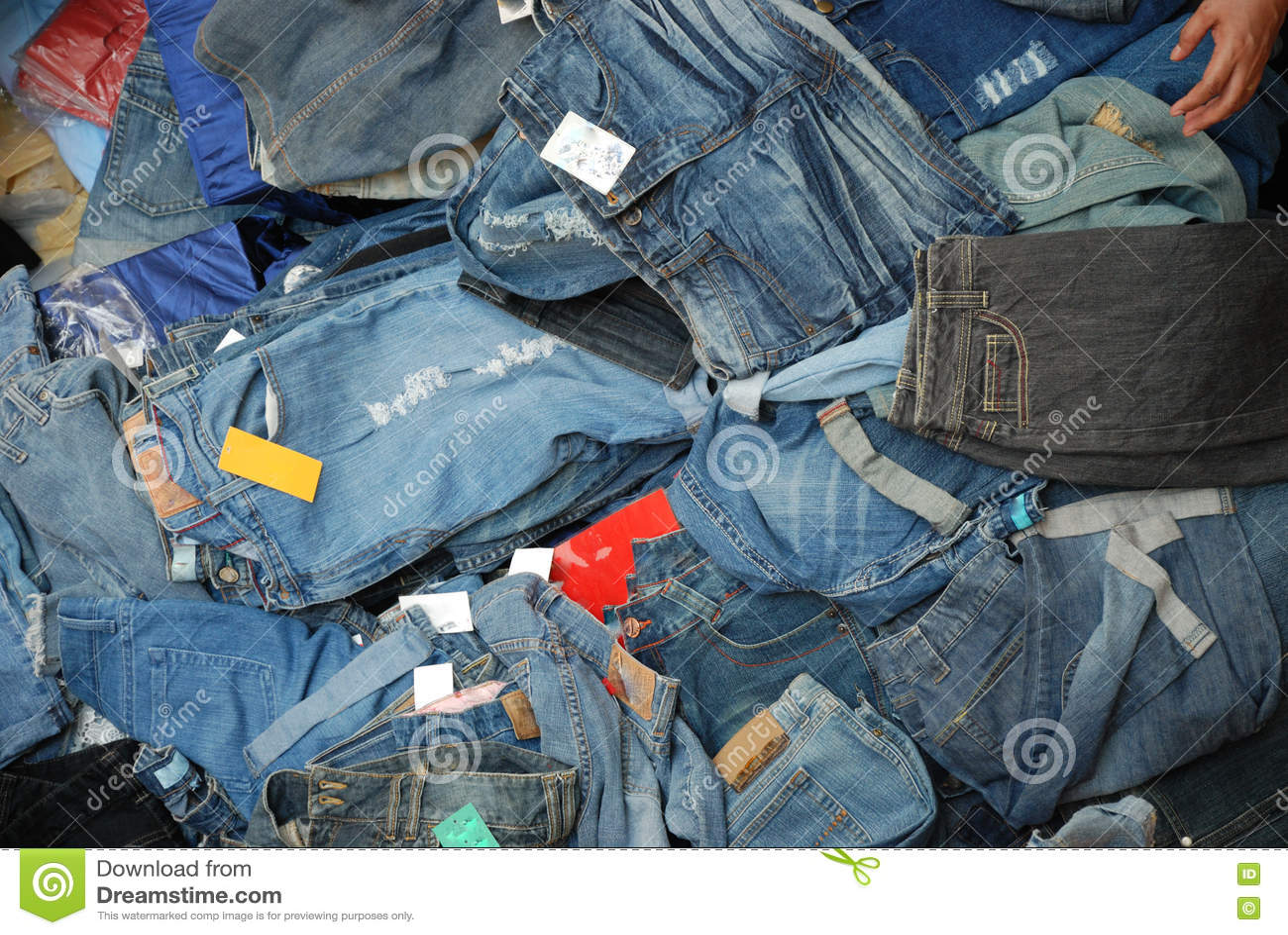 a pile of jeans denim pants stock photo image 76351237. Black Bedroom Furniture Sets. Home Design Ideas