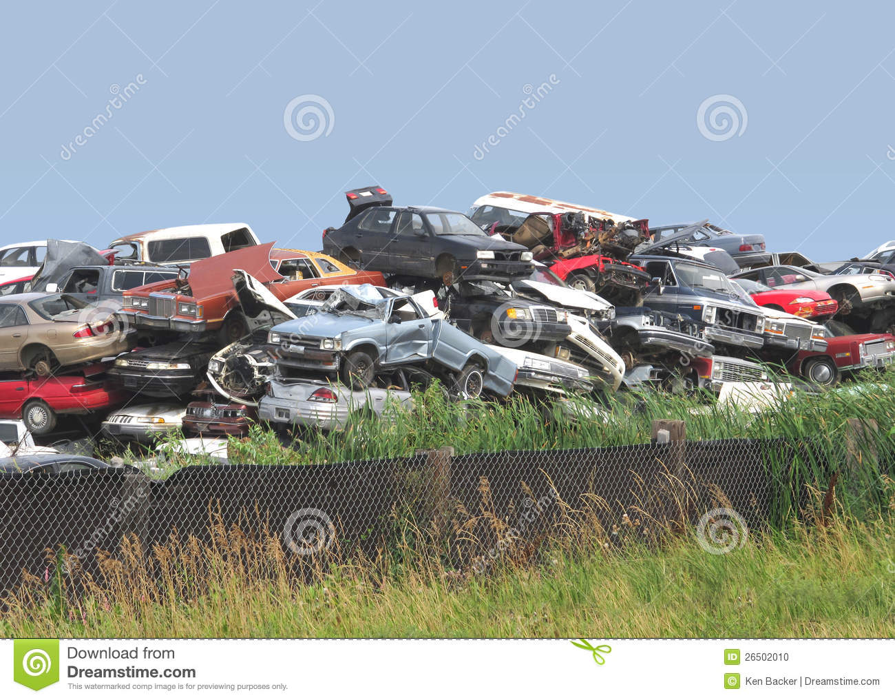 pile of junked and wrecked cars stock photo