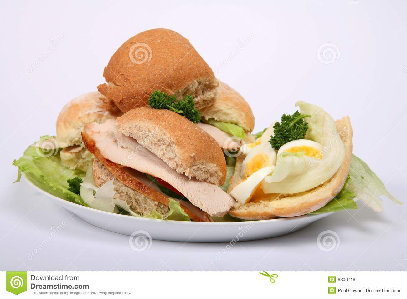Pile of meat and salad sandwiches