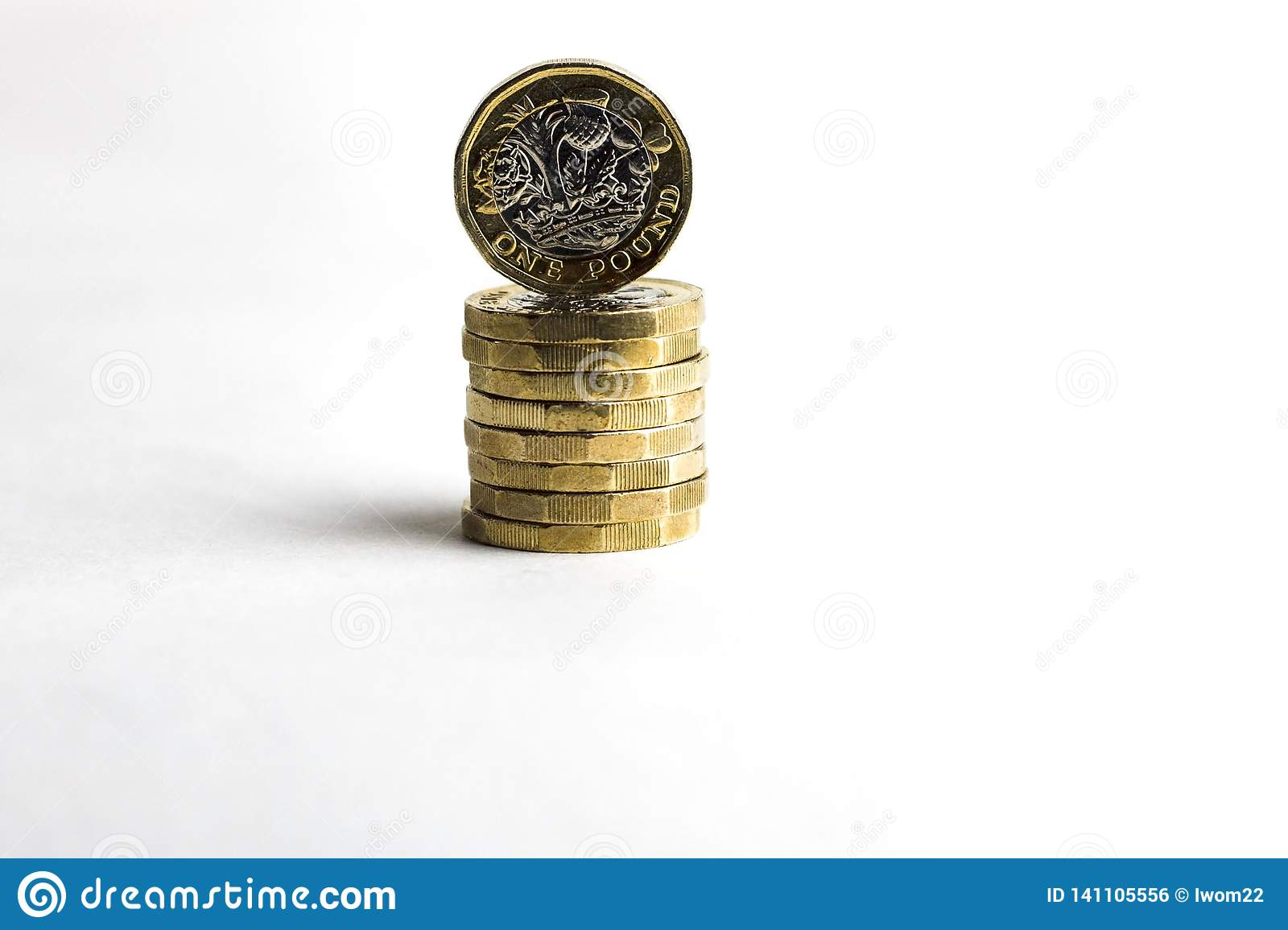 Pile of one pound coins.