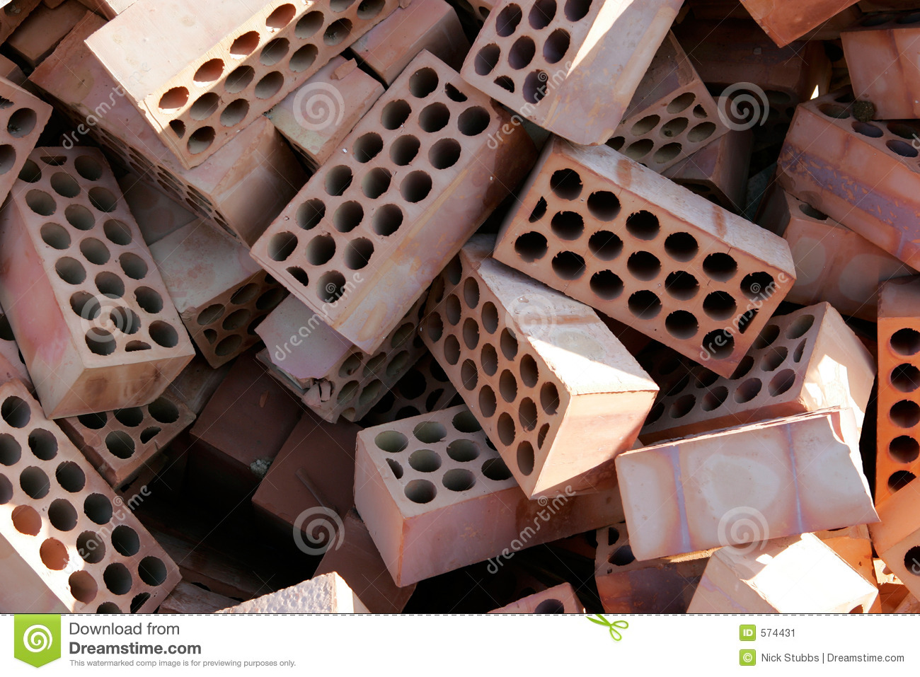 Pile Of Red Bricks With Cirlces Or Holes