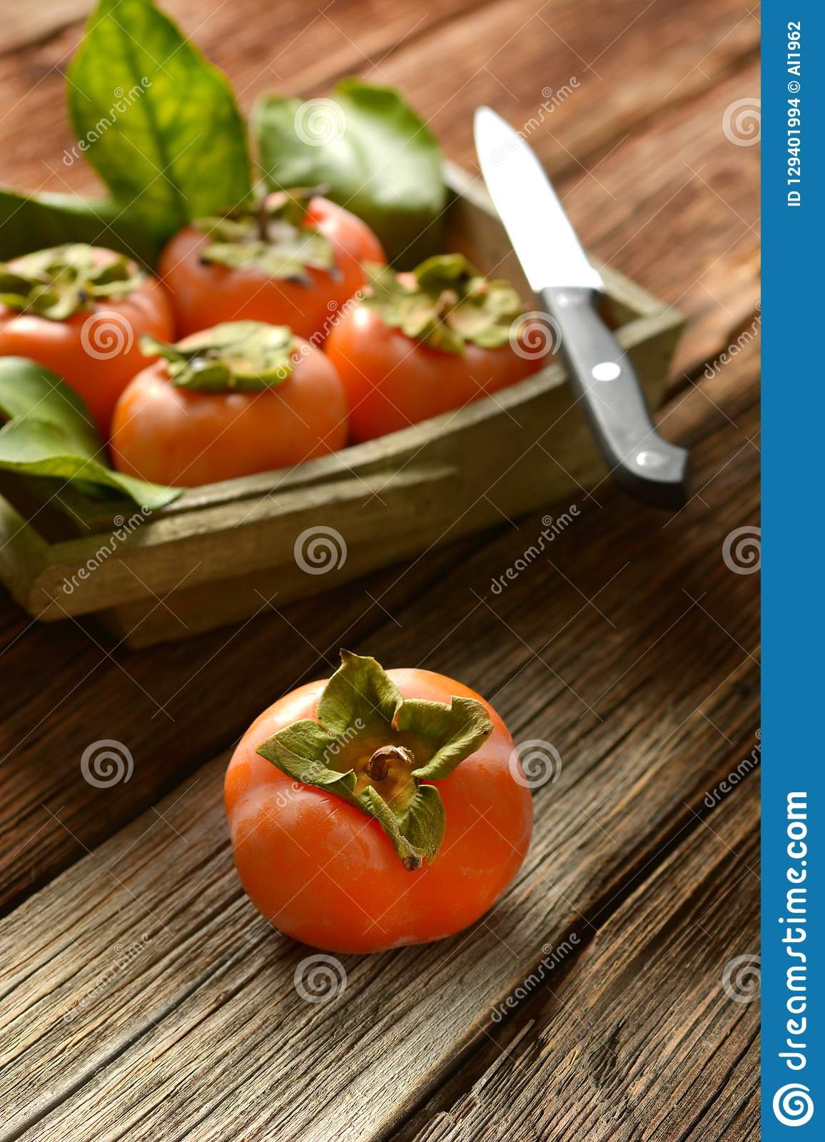 Pile of ripe persimmons on wooden table. Closeup stock images