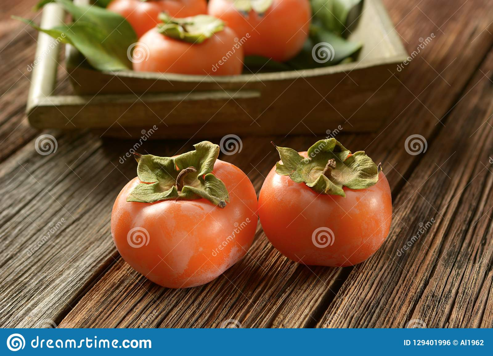 Pile of ripe persimmons on wooden table. Closeup royalty free stock image