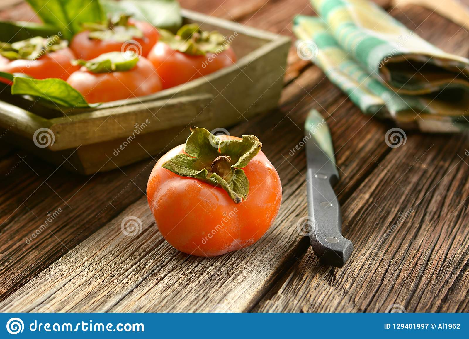 Pile of ripe persimmons on wooden table. Closeup royalty free stock photography