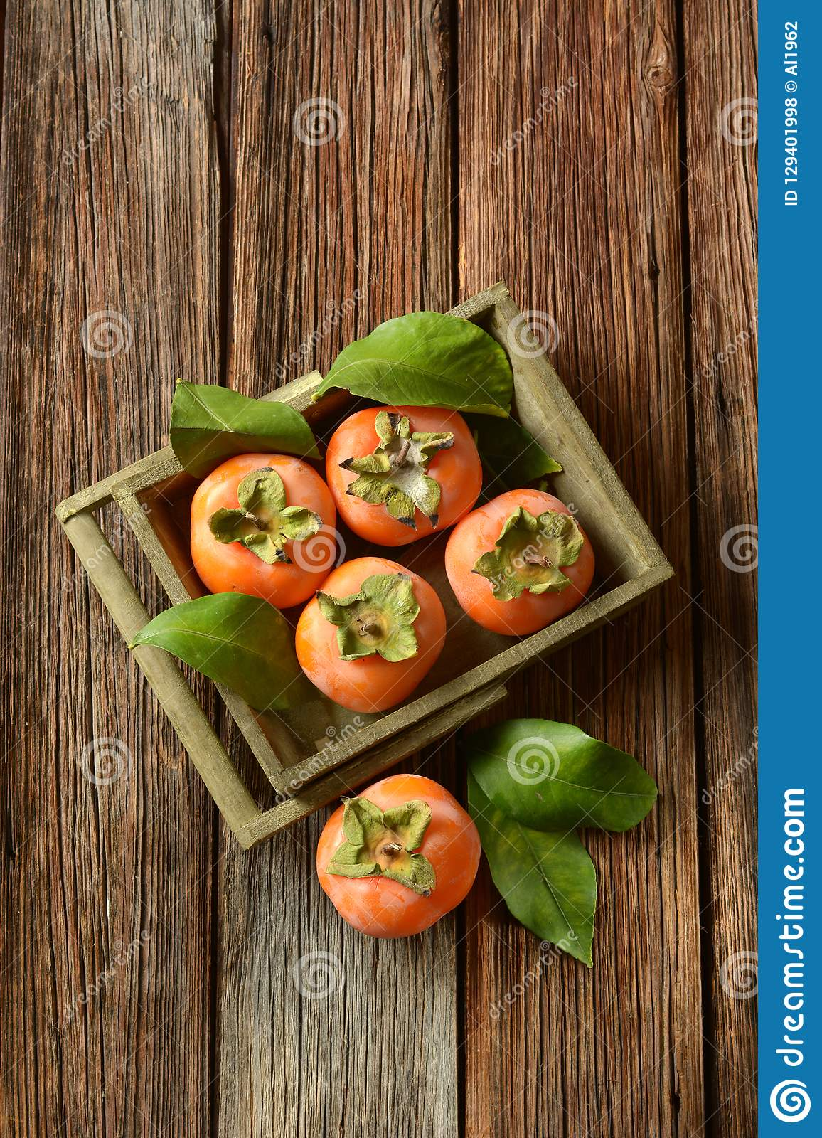 Pile of ripe persimmons on wooden table. Closeup royalty free stock photos