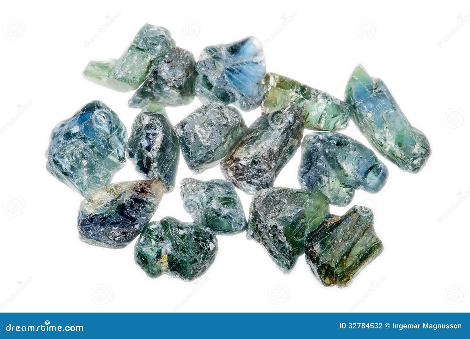 A Pile Of Rough Uncut Light Blue Green Sapphires Stock Photo