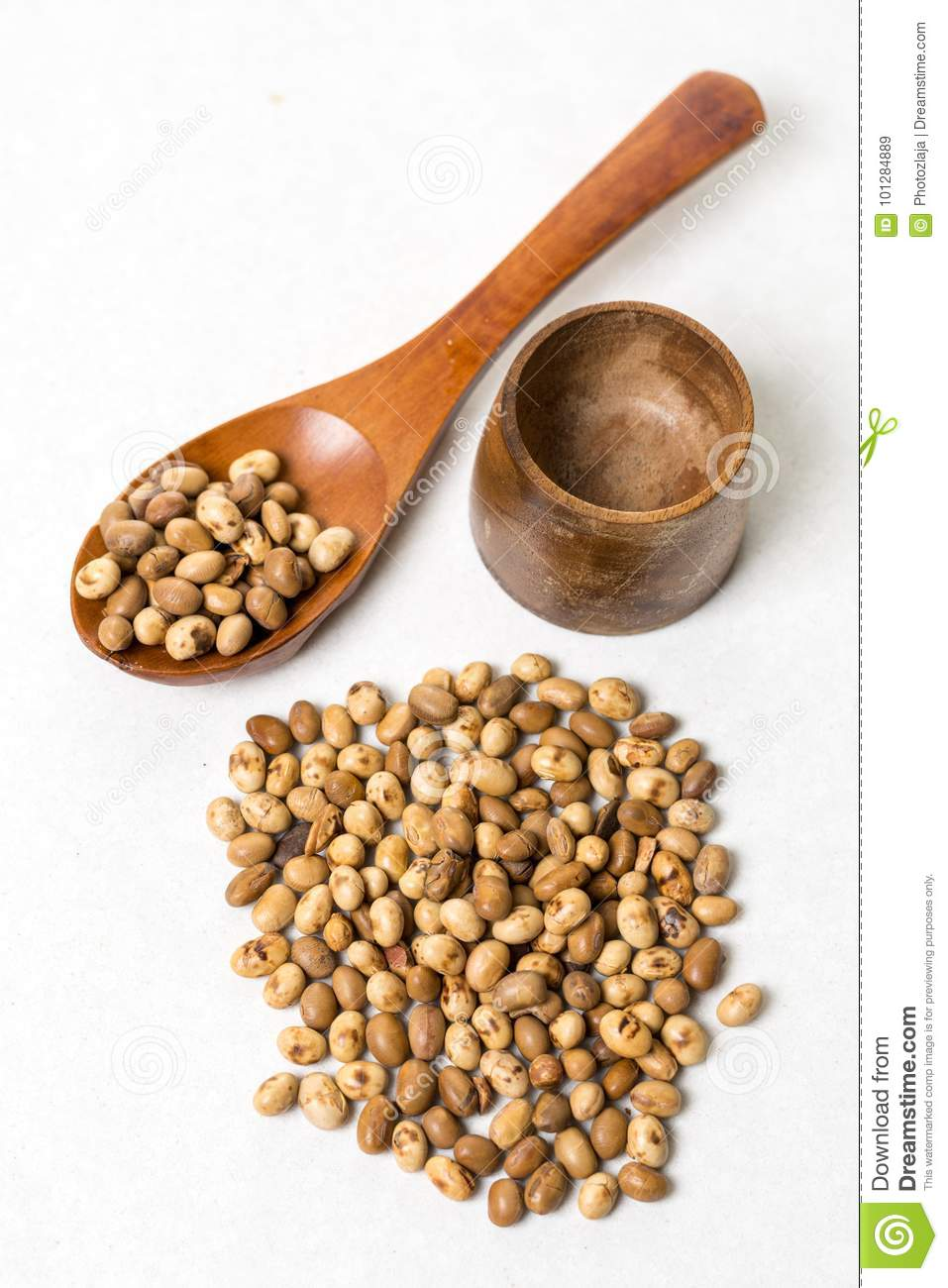 Pile Of Soya Beans With Wooden Spoon On The White Marble