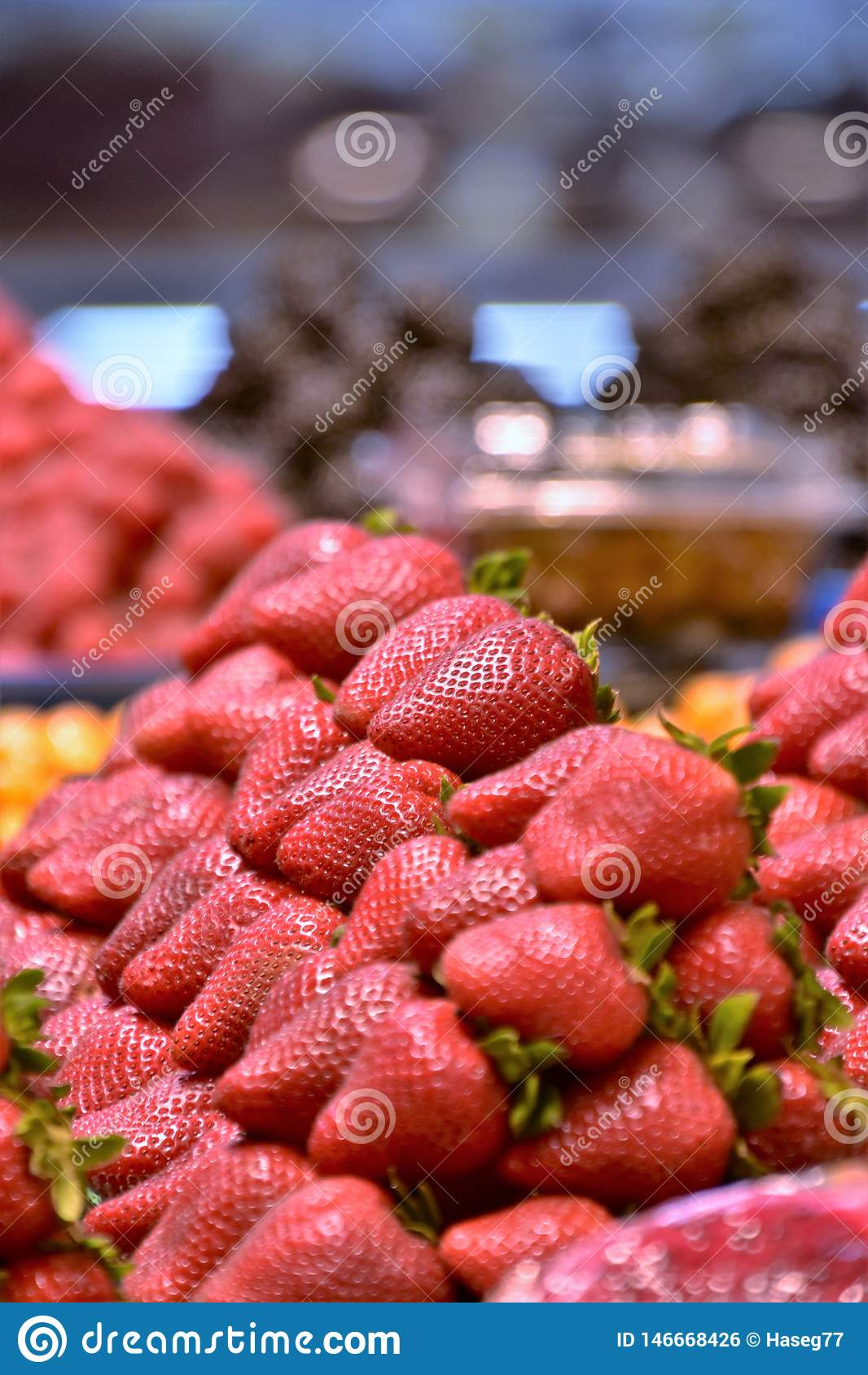 Pile of Strawberries on the pallet.