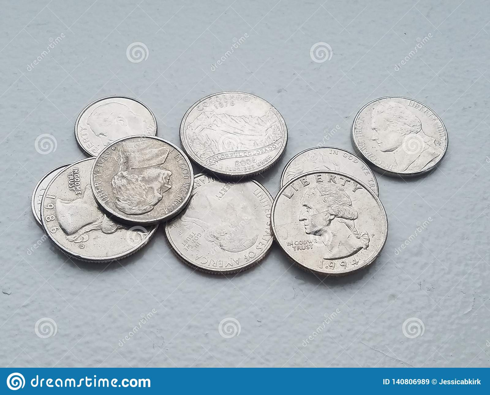 Pile of US coins currency Liberty dime and quarters from directly above