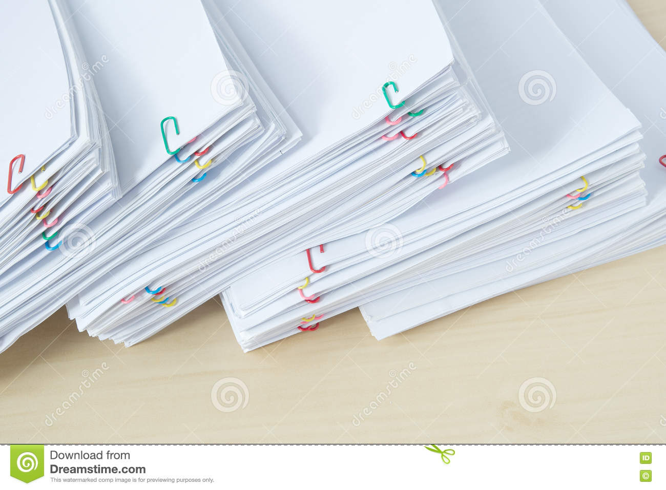 Pile Of Workload Paper And Reports With Colorful Paper Clip Stock ...