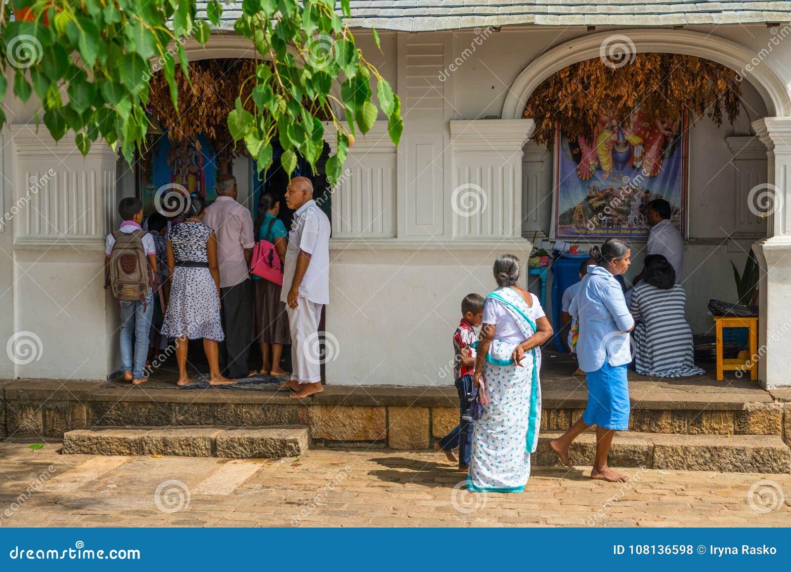 Pilgrims near small Vishnu shrine in Golden cave temple complex.