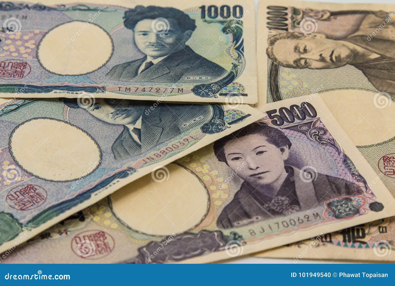 A pilha de muitos datilografa cédulas fundo de japão, moeda dos ienes