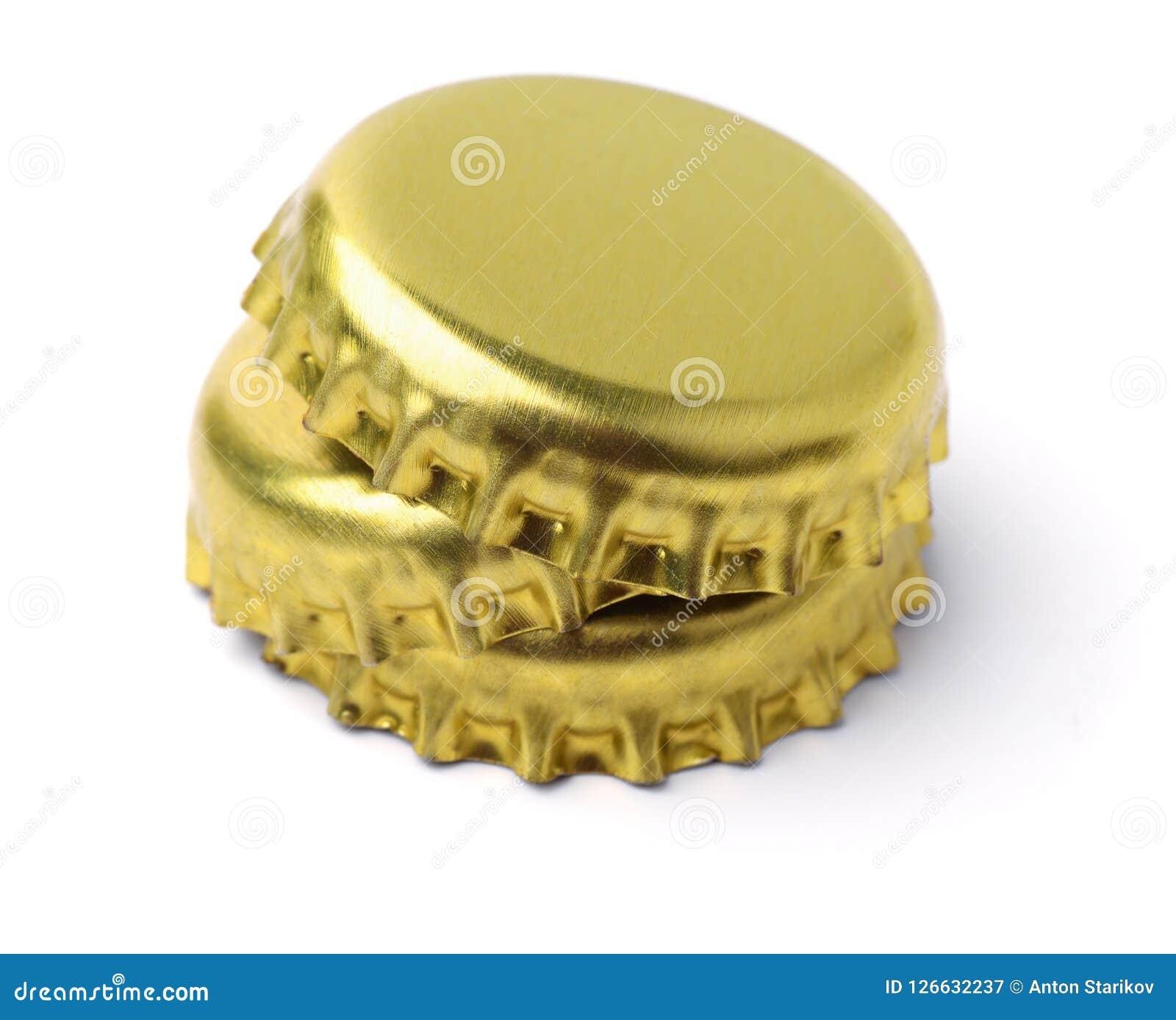 Pilha de tampões de garrafa dourados Fotografia de Stock Royalty Free