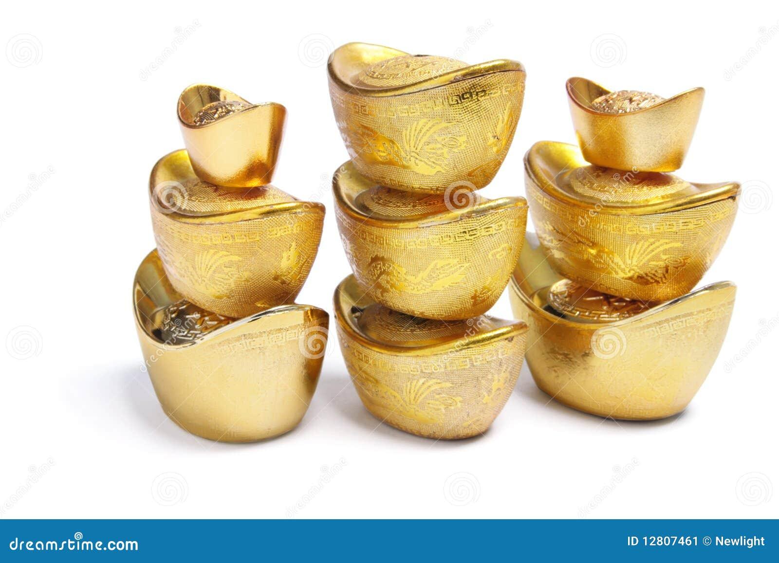 Pilhas de lingotes chineses do ouro
