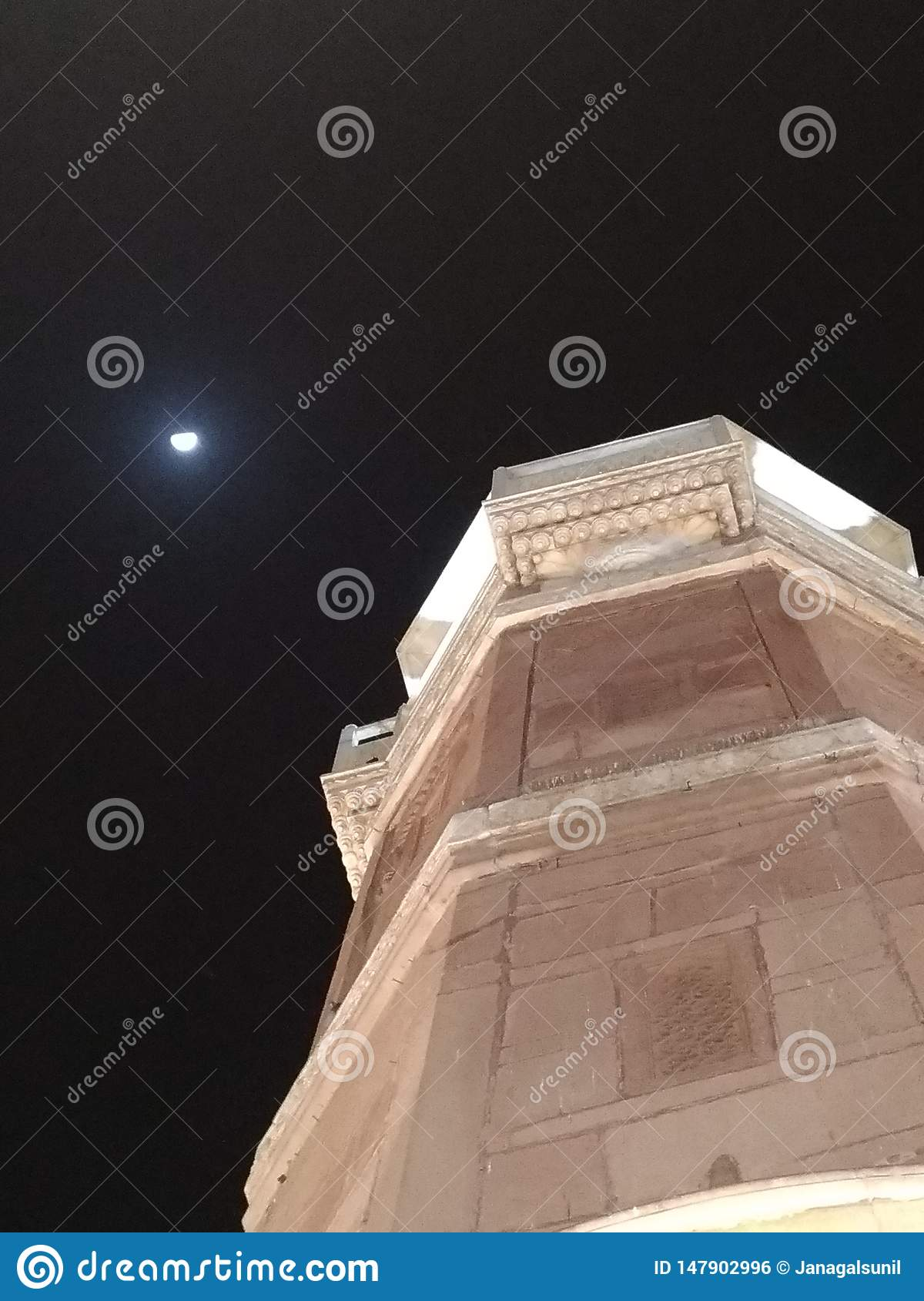 the pillar of victorious with shy moon at night sky