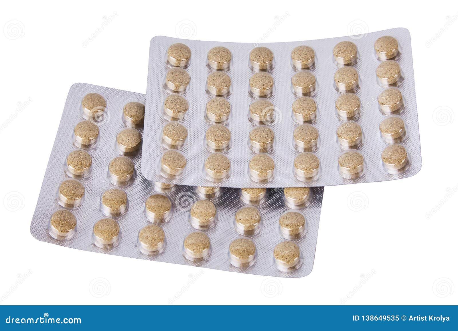 Piller eller minnestavlor för medicin försilvrar växt- in blåsor på vit bakgrund