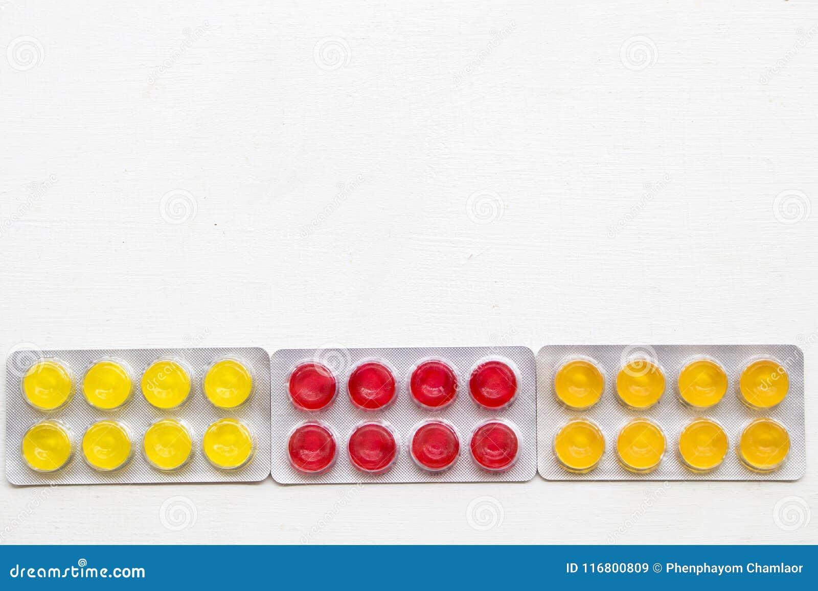 Pillole variopinte della pastiglia per la gola irritata di tosse