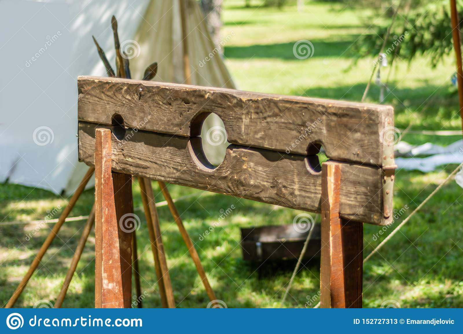 The pillory, wooden frame usually mounted on a post where the criminal would place their head and hands through the holes
