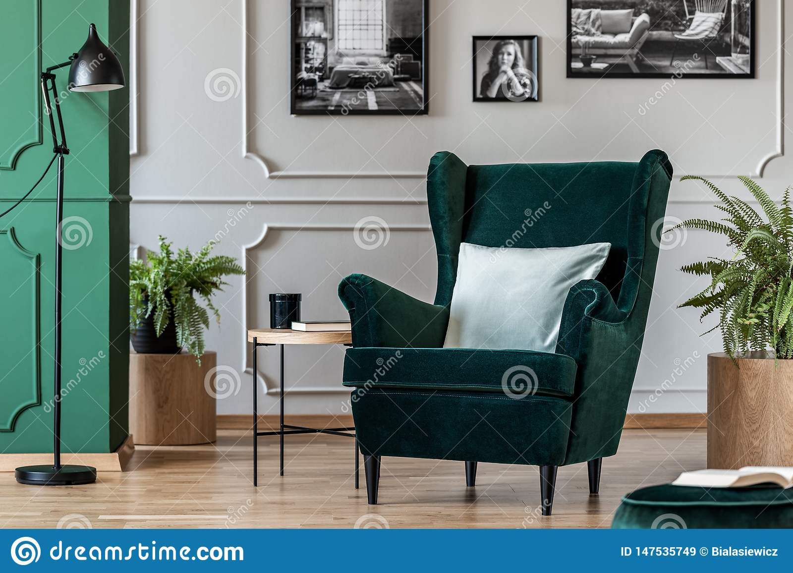 Pillow On Emerald Green Armchair In Elegant Living Room With
