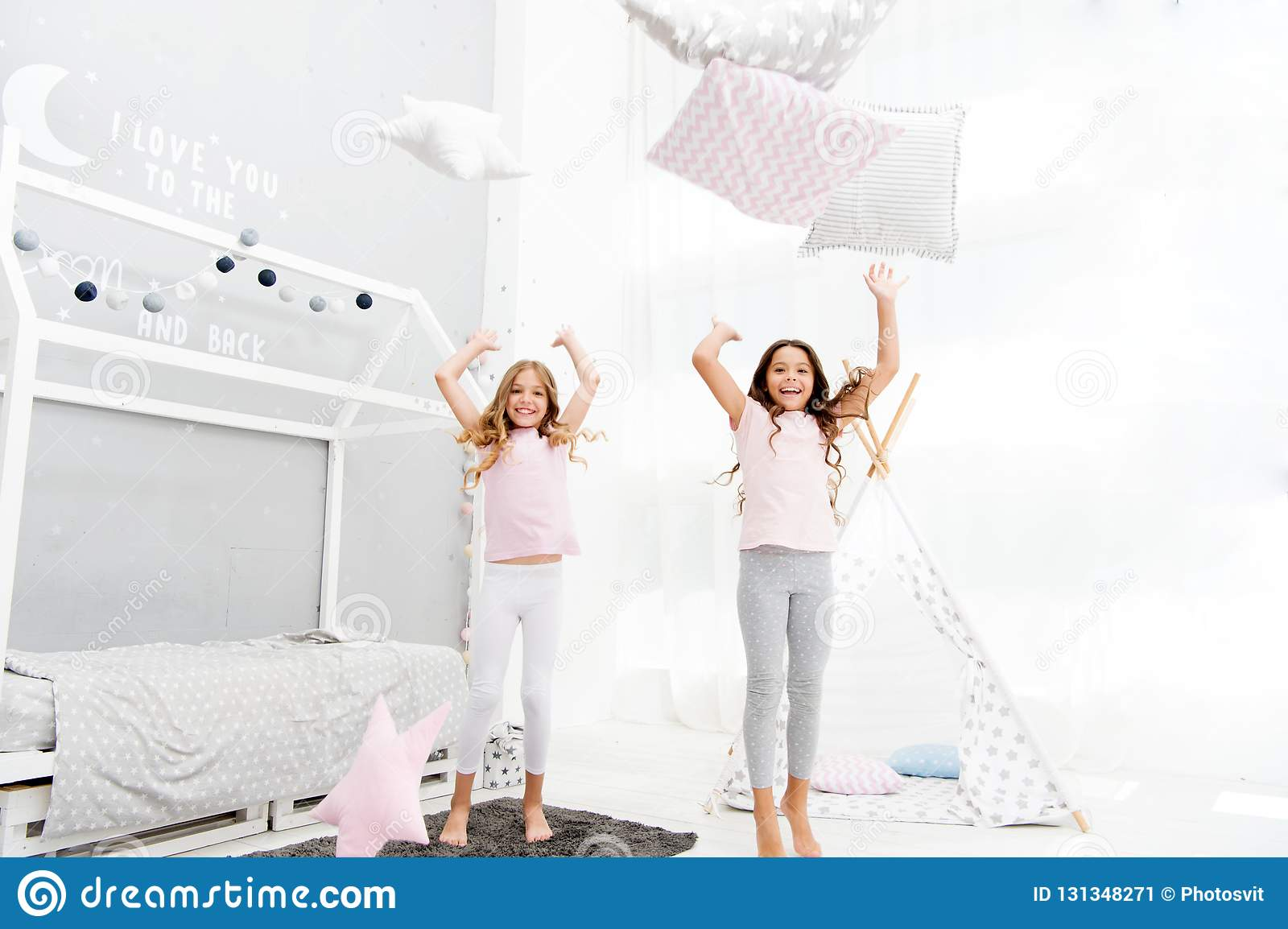 4341fa0086 Pillow fight pajama party. Evening time for fun. Sleepover party ideas. Girls  happy best friends or siblings in cute stylish pajamas with pillows  sleepover ...