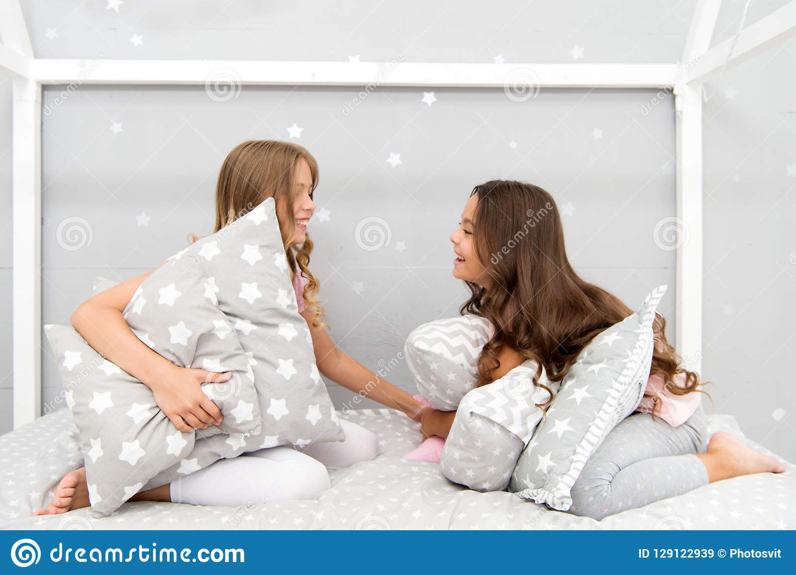 b6d008a15c Sleepover time for pillow fight. Girls sleepover party ideas. Soulmates  girls having fun sleepover party. Girls happy best friends in pajamas with  pillows ...