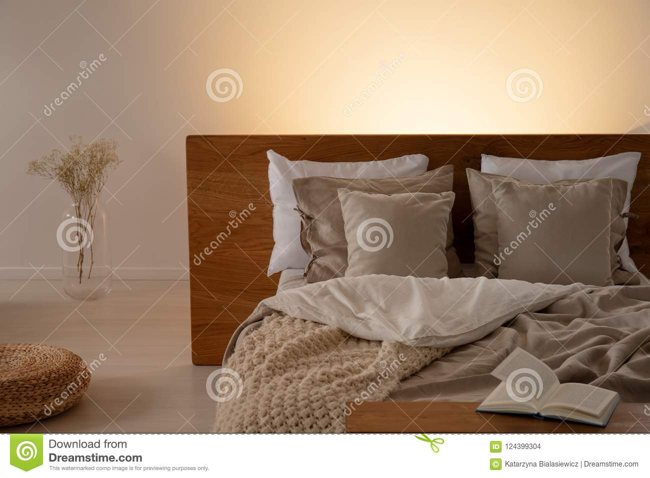 Wonderful Download Pillows And Sheets On Bed With Headboard In Dark Bedroom Interior  With Flowers And Book