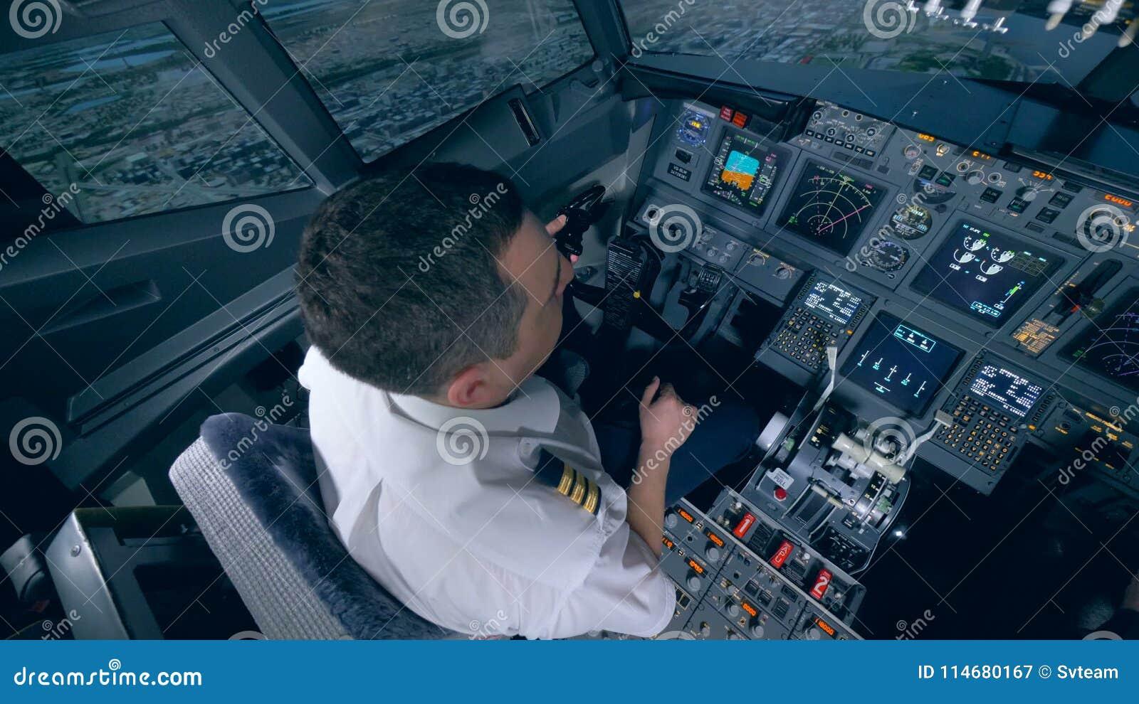 The pilot controls the plane in flight simulator