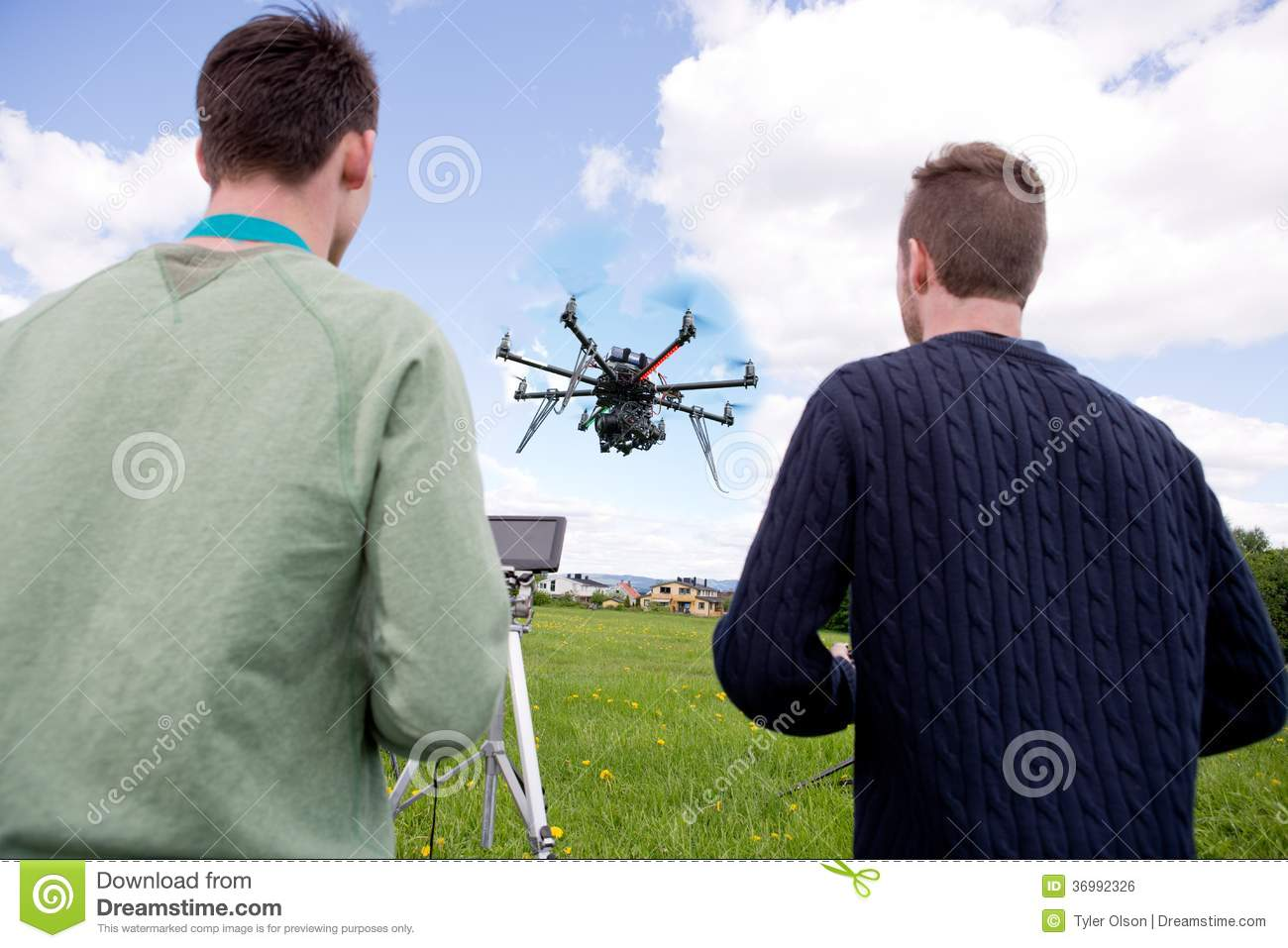 Pilot and Photographer Operating Photography Drone