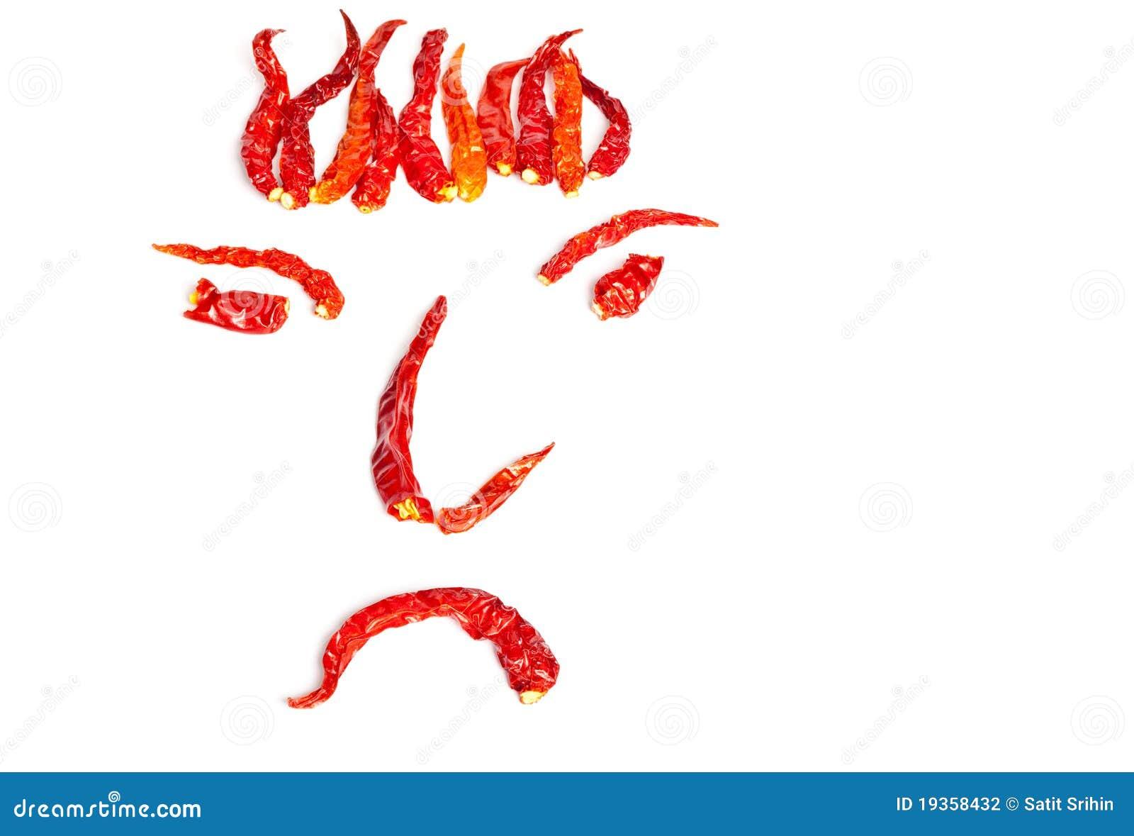 Pimentões encarnados secados em uma forma da face