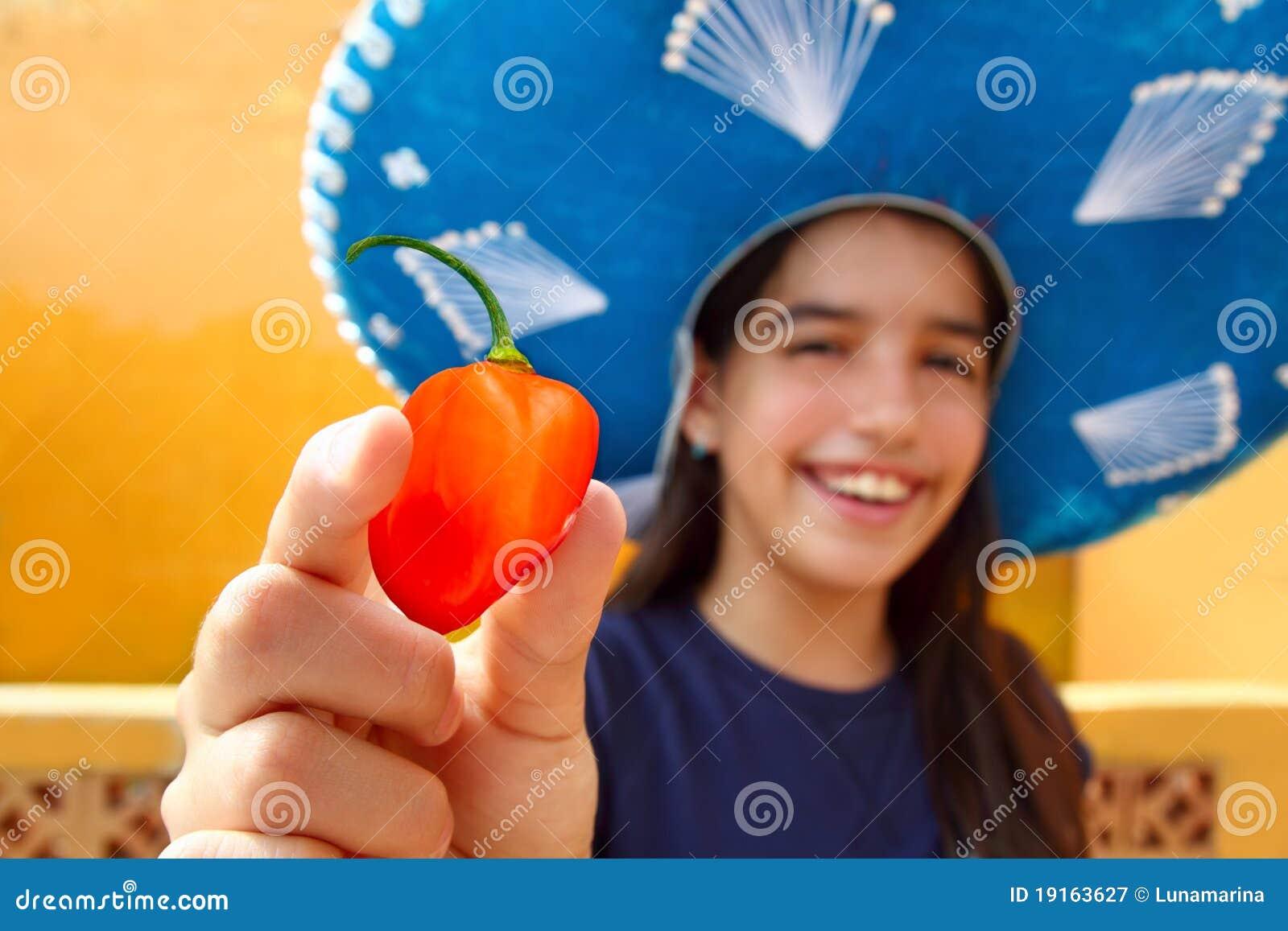 Pimenta de pimentão quente alaranjada do habanero mexicano da menina