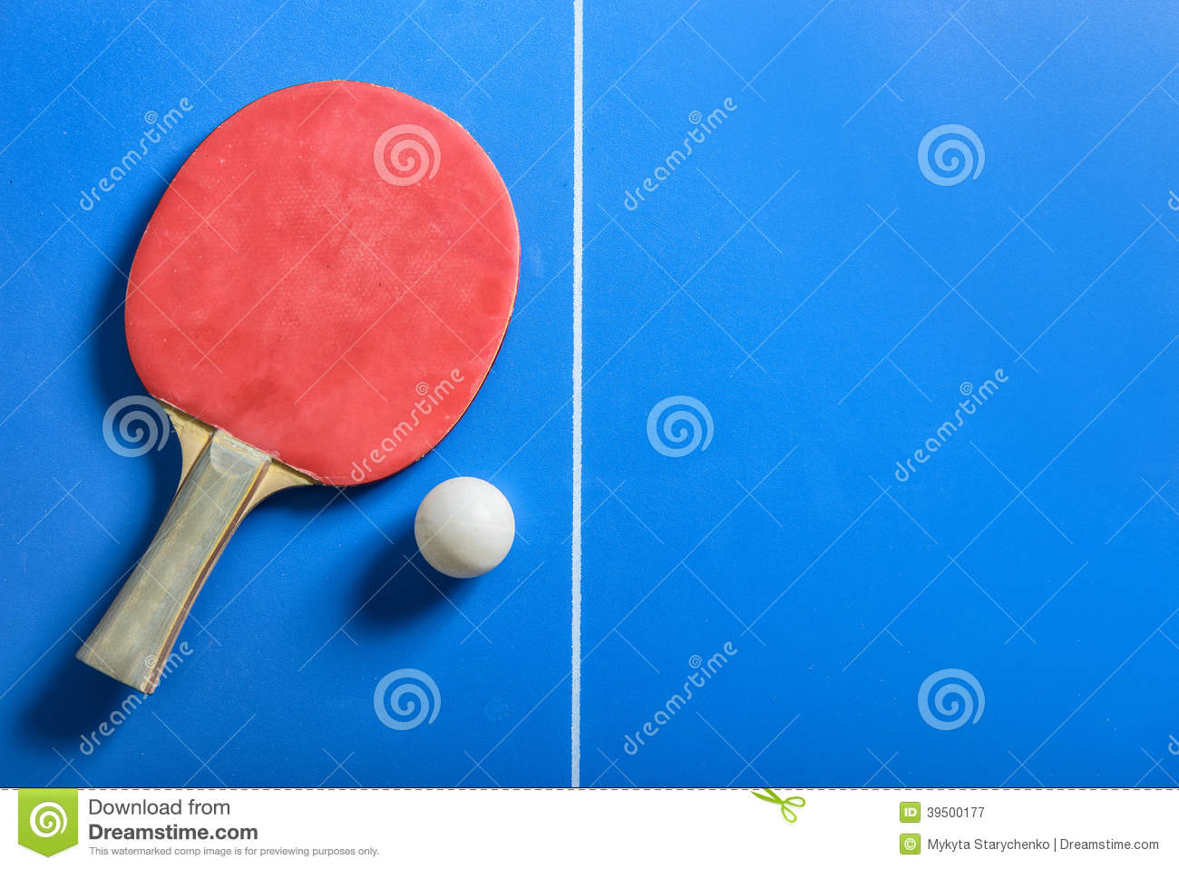 Pin pong ball and red paddle on blue board