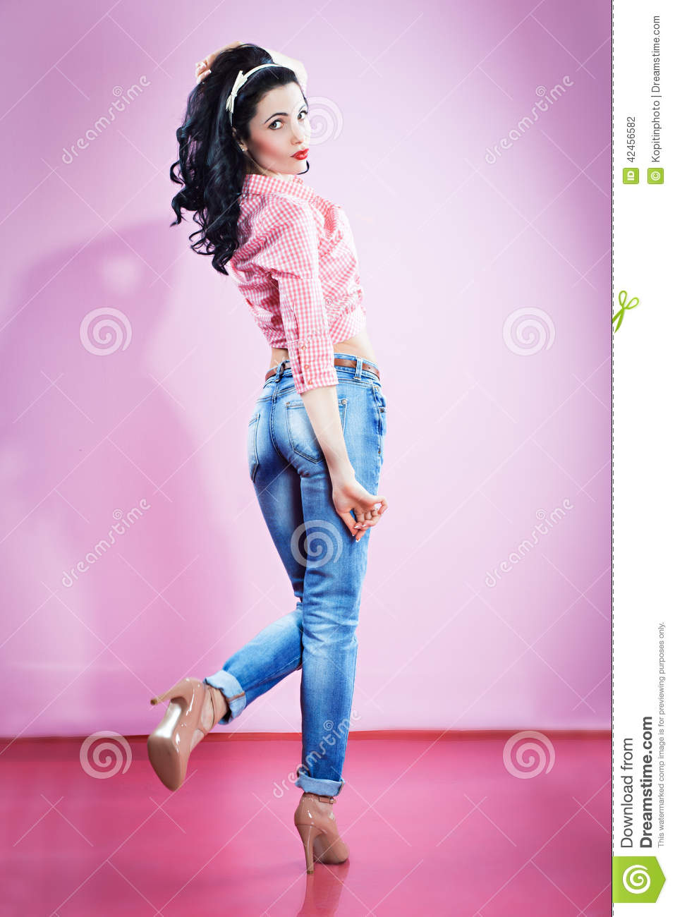 pin up girl in blue jeans stock photo image 42456582. Black Bedroom Furniture Sets. Home Design Ideas