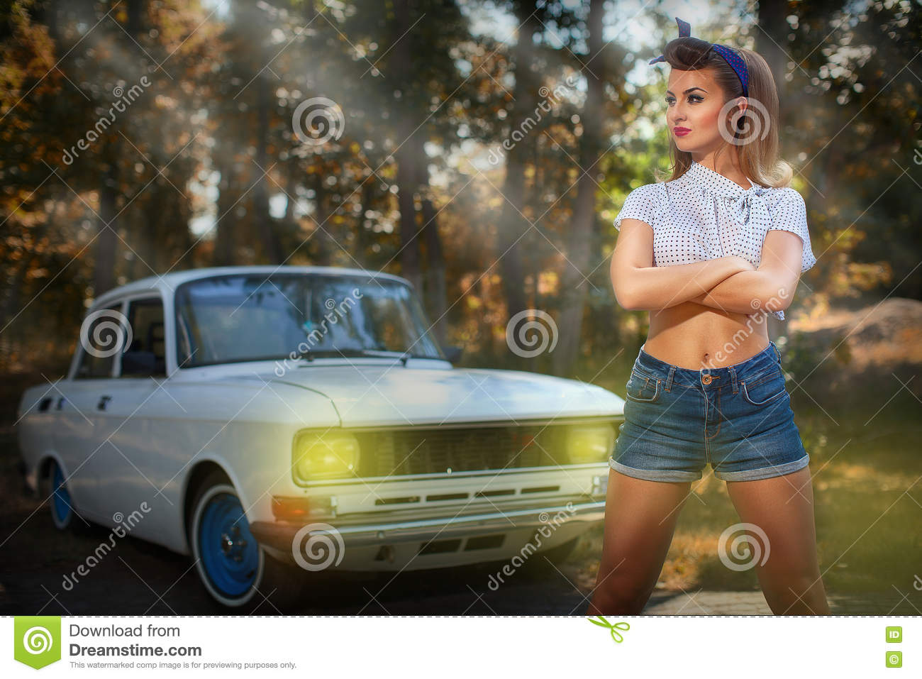 Pin-up girl near retro car on a background of forest