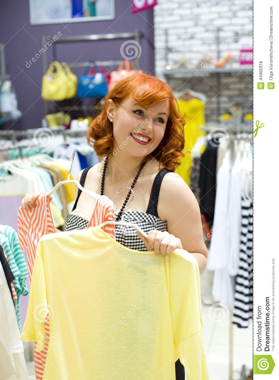 Pin-up girl is shopping in a clothing store