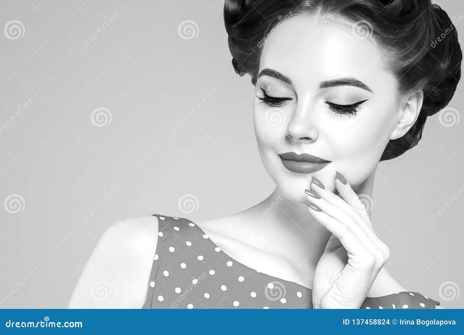 Retro. Portrait Of Pensive Pinup Girl Dreaming Stock Photo
