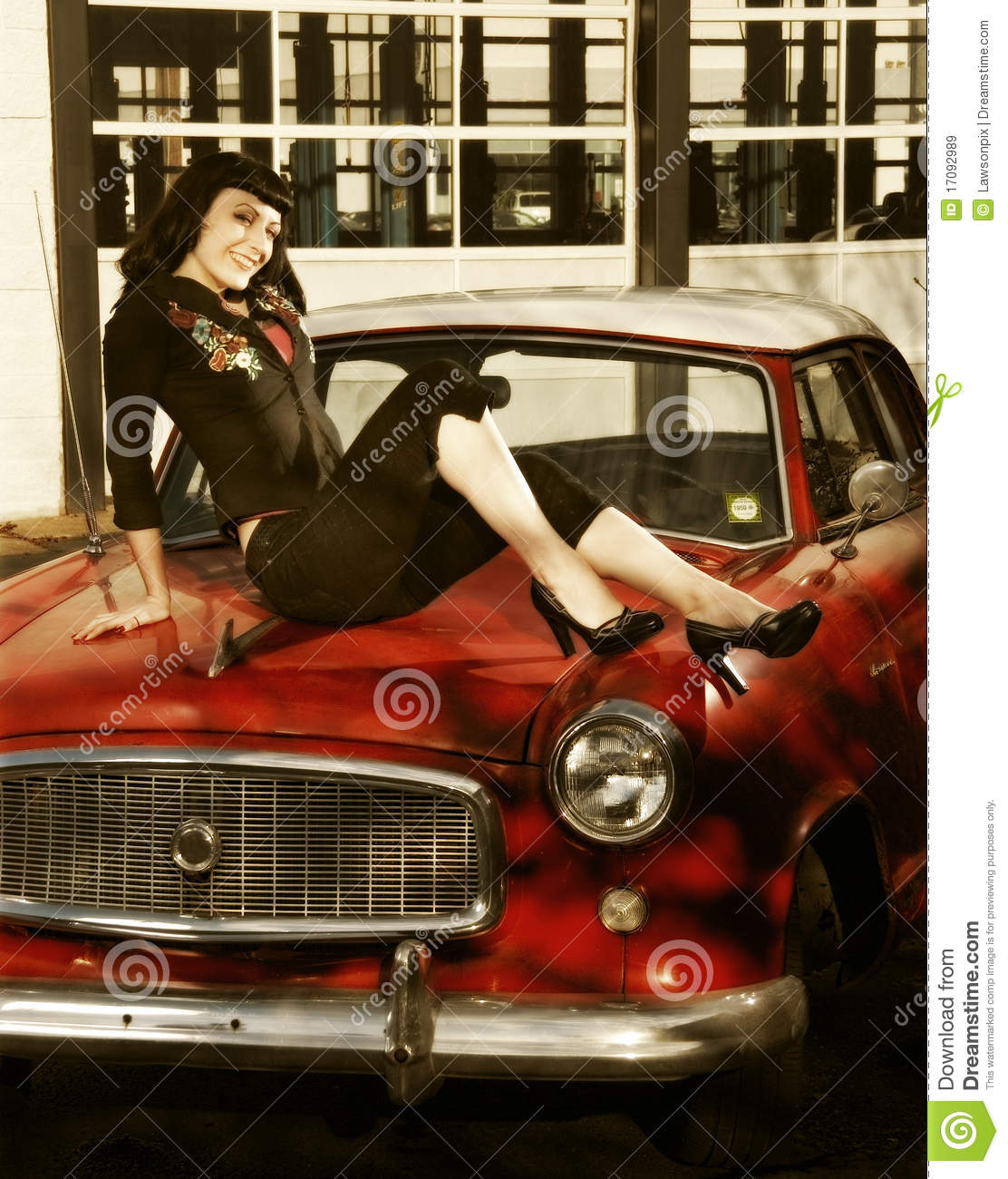 pin up style model sitting on an antique car royalty free stock images image 17092989. Black Bedroom Furniture Sets. Home Design Ideas
