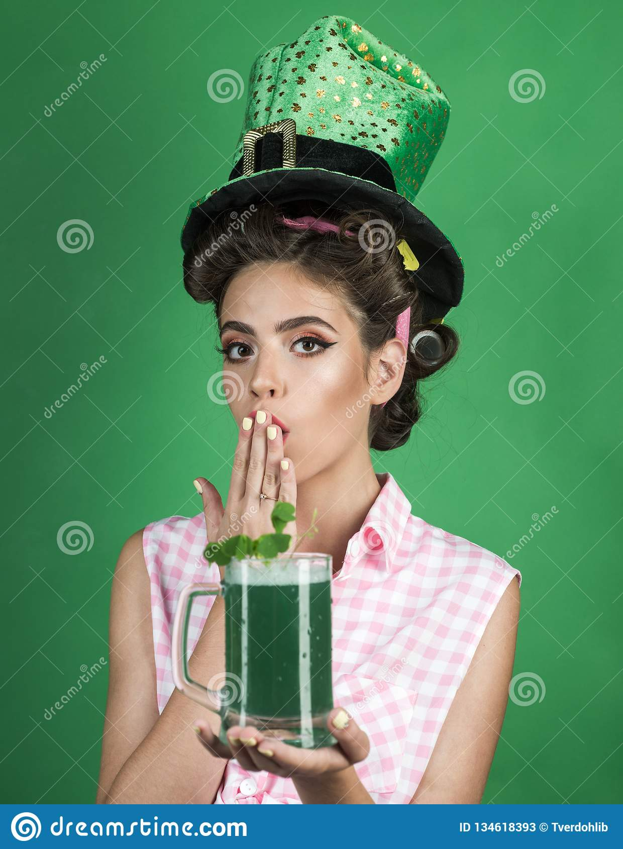 Pin up woman with trendy makeup. pinup girl with fashion hair. retro woman drink summer cocktail. St. Patricks Day