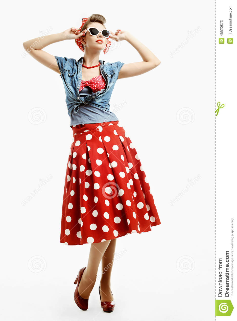Pin Up Young Woman In Vintage American Style Trying On A