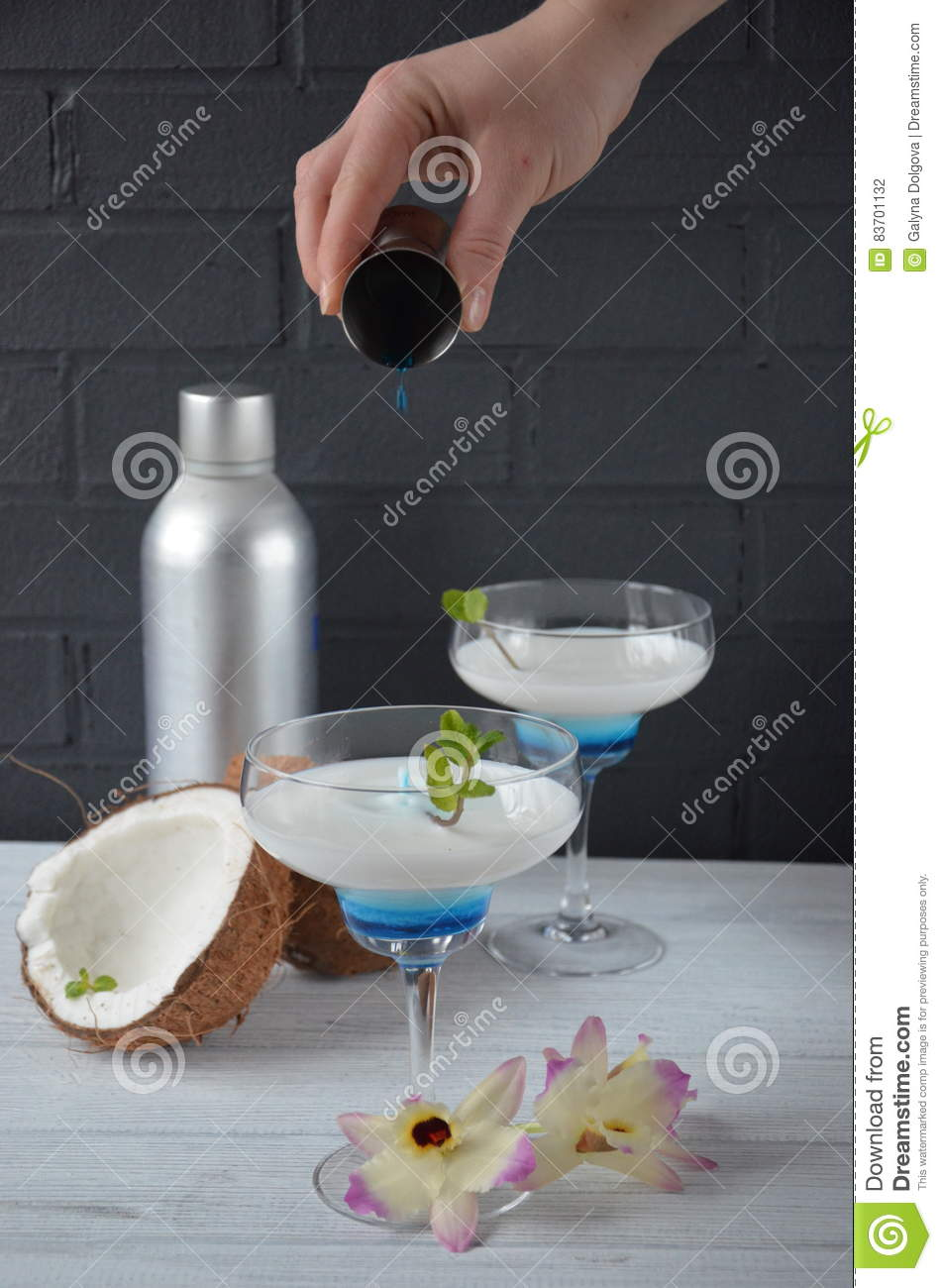 Pina Colada Drink In Cocktail Glass Decorated With Coconut And Orchid Flowers Stock Photo